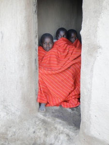 Maasai boys, tired and hungry after herding cattle all day